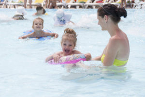 chidren having fun a public pool